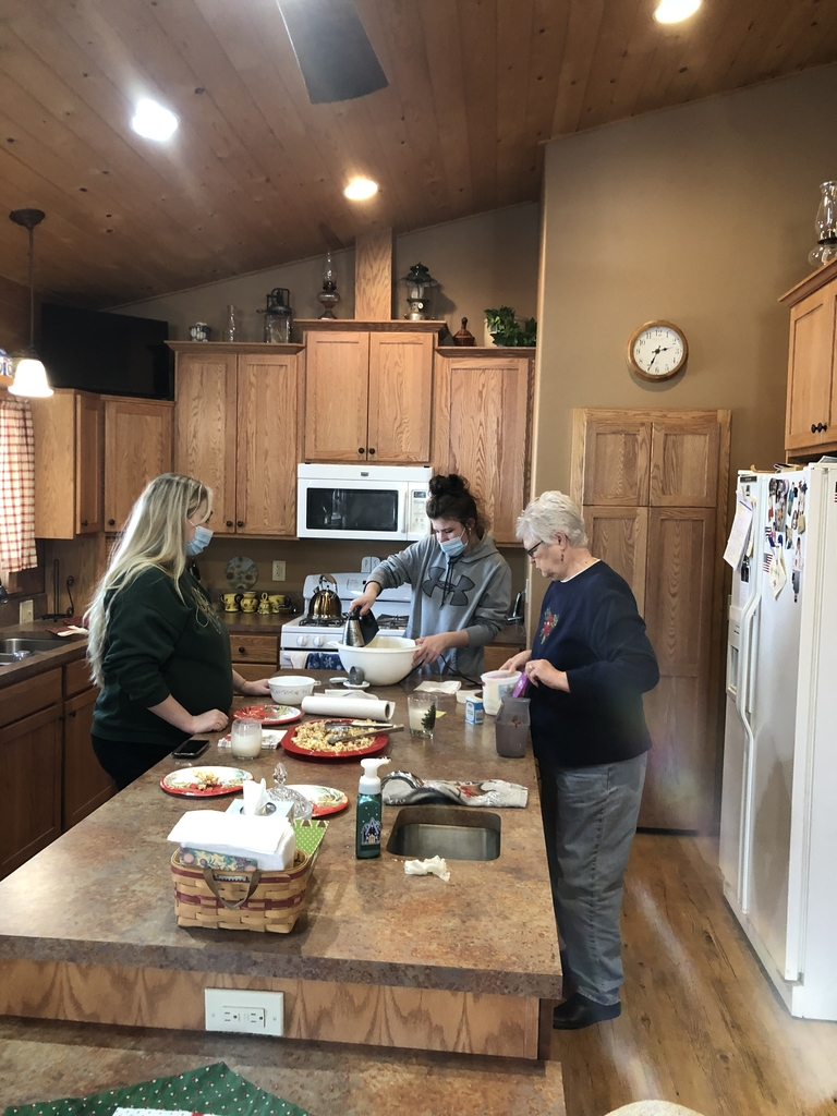 Mrs Bell, Brooklynn, and Mrs Hayzlett making a second batch of eggnog.