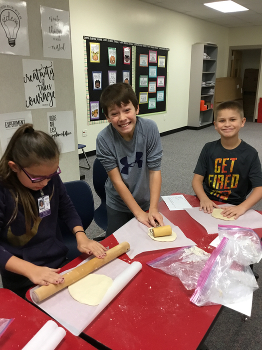 Ari, Quincy & Adriel rolling out their dough