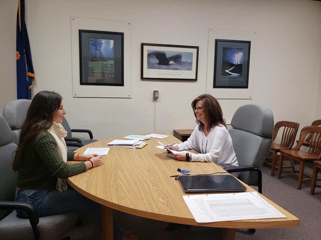 Volunteer Jana Jenkinson from Kearny County Court House interviews Fernanda Oliveira.
