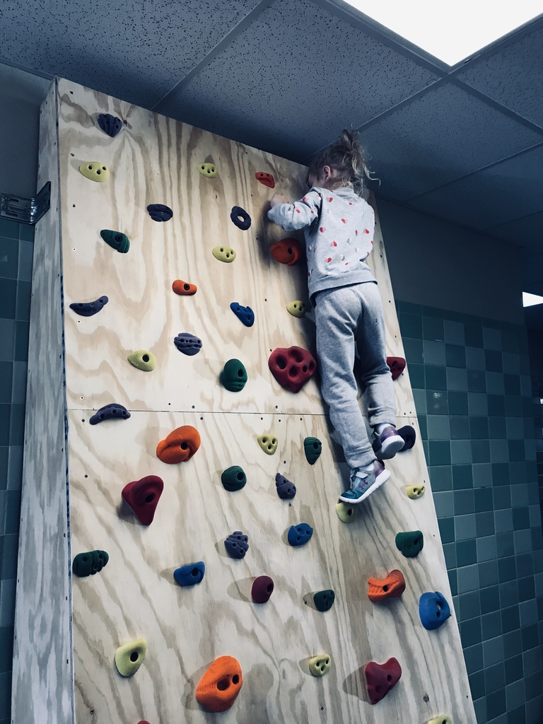 Kinder prep loves the rock wall.