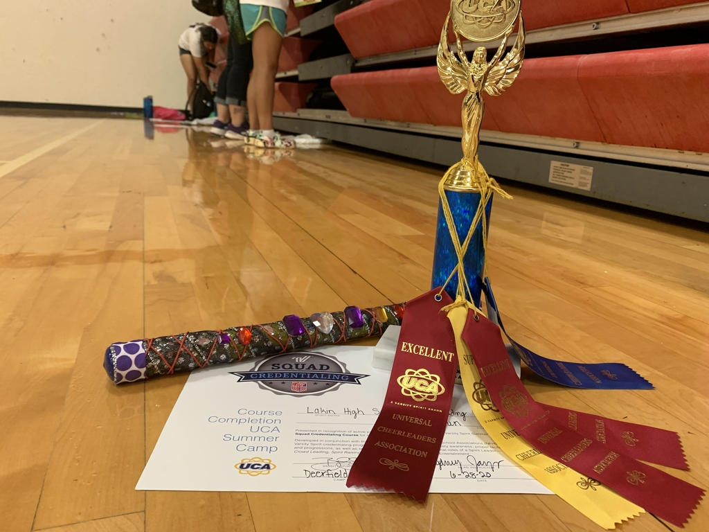 Squad credentialing certificate, a superior trophy, spirit stick and ribbons!